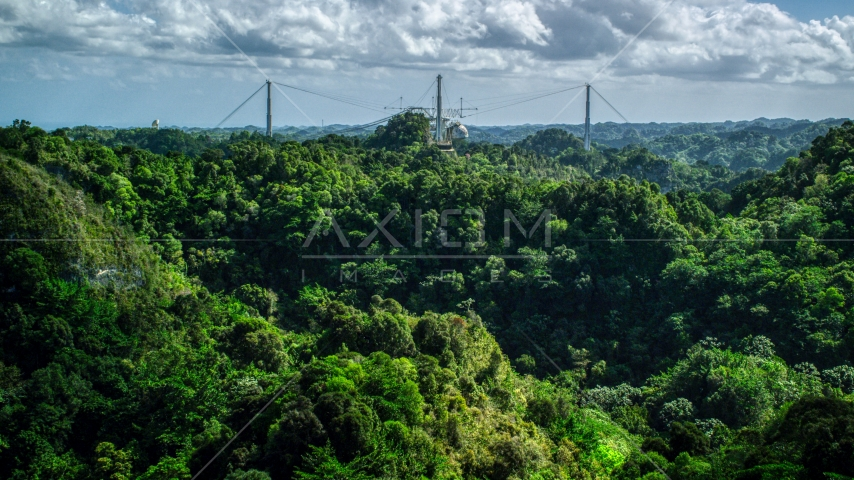 Arecibo Observatory seen from lush green mountains, Puerto Rico  Aerial Stock Photo AX101_108.0000184F | Axiom Images