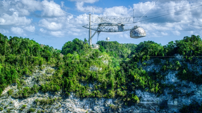 Top structure of the Arecibo Observatory and karst mountains in Puerto Rico Aerial Stock Photos | AX101_116.0000000F