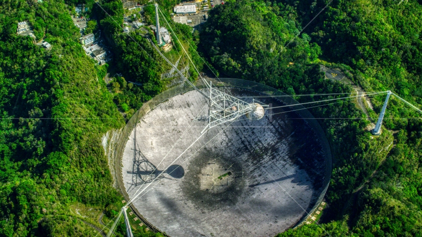 A bird's eye of the Arecibo Observatory in Puerto Rico Aerial Stock Photo AX101_121.0000000F | Axiom Images