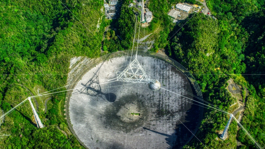 Looking down at the Arecibo Observatory dish in Puerto Rico  Aerial Stock Photos | AX101_122.0000000F