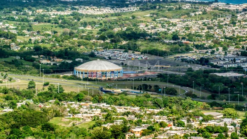 Coliseo Manuel Iguina sporting arena and homes, Arecibo, Puerto Rico Aerial Stock Photo AX101_132.0000000F | Axiom Images