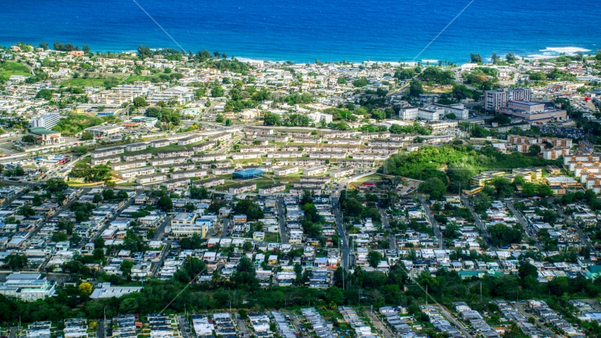 Coastal homes and apartment buildings in Arecibo, Puerto Rico  Aerial Stock Photos | AX101_134.0000081F
