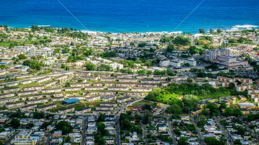 Houses and apartment buildings near the Caribbean island coast, Arecibo, Puerto Rico Aerial Stock Photos | AX101_135.0000000F