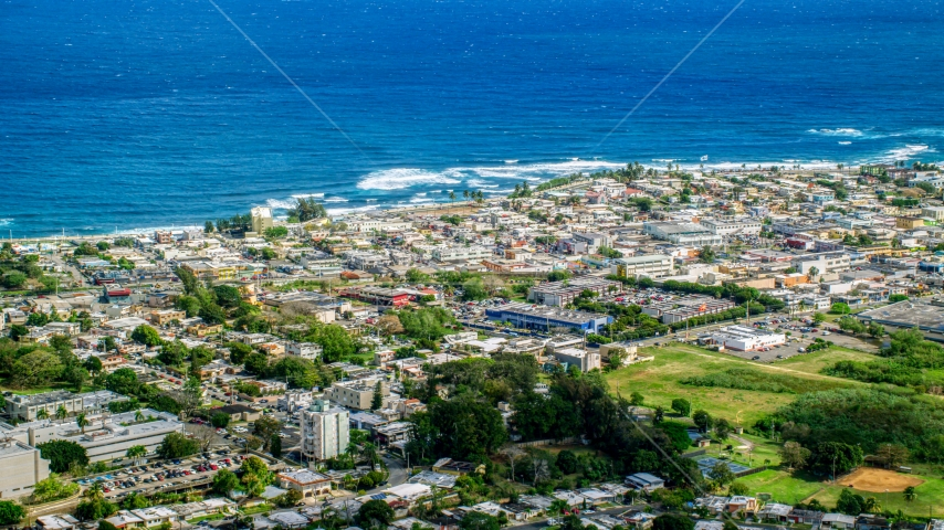 Coastal community homes and apartment buildings, Arecibo, Puerto Rico  Aerial Stock Photo AX101_136.0000000F | Axiom Images