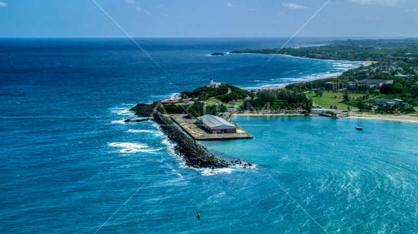 The Arecibo Lighthouse overlooking the blue Caribbean waters, Puerto Rico Aerial Stock Photo AX101_141.0000000F | Axiom Images