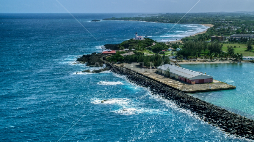 Arecibo Lighthouse and the blue waters of the Caribbean, Puerto Rico  Aerial Stock Photos | AX101_142.0000000F
