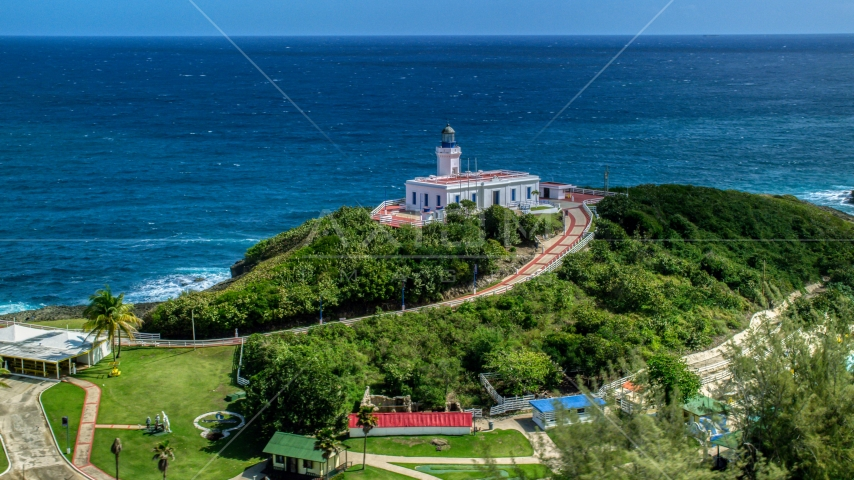 Arecibo Lighthouse with a view of the coastal waters of the Caribbean, Puerto Rico  Aerial Stock Photos | AX101_144.0000000F