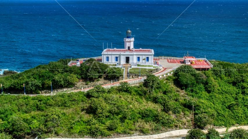 Arecibo Lighthouse beside the coastal waters of the Caribbean, Puerto Rico  Aerial Stock Photos | AX101_144.0000277F