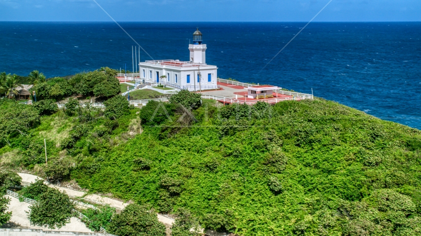 Arecibo Lighthouse and clear blue Caribbean waters, Puerto Rico  Aerial Stock Photo AX101_145.0000210F | Axiom Images