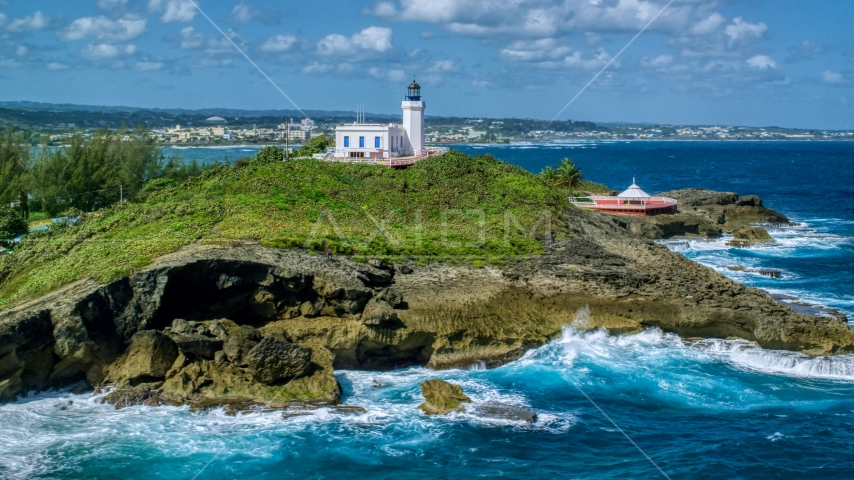 Arecibo Lighthouse on the Caribbean island coast, Puerto Rico  Aerial Stock Photo AX101_147.0000000F | Axiom Images