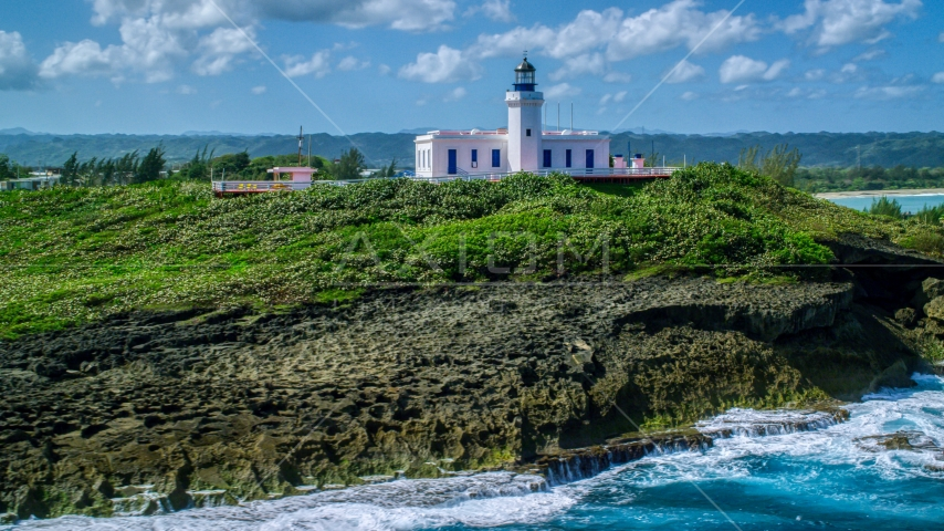 The Arecibo Lighthouse on the island coast, Puerto Rico Aerial Stock Photo AX101_148.0000000F | Axiom Images