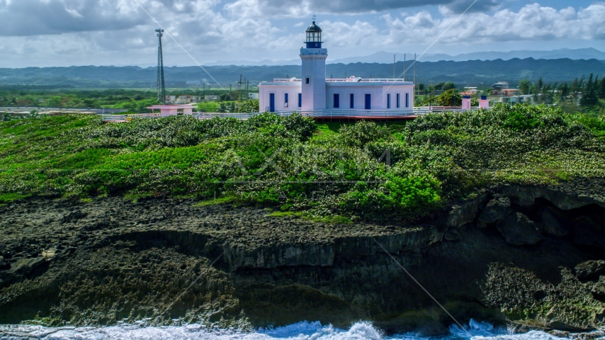 The Arecibo Lighthouse overlooking the island coast, Puerto Rico Aerial Stock Photo AX101_148.0000244F | Axiom Images