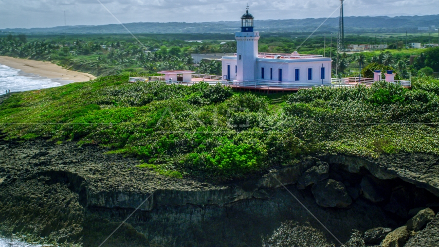 The hilltop Arecibo Lighthouse in Puerto Rico  Aerial Stock Photos | AX101_149.0000000F