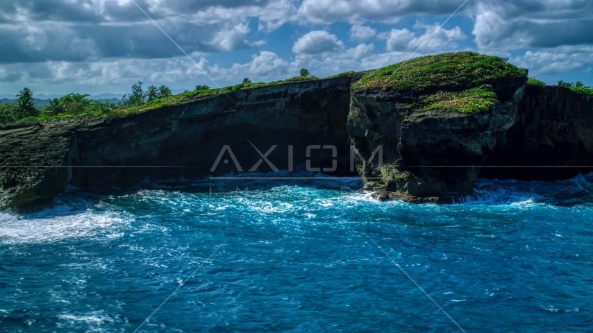 Rugged rock formation on the Caribbean island coast in Arecibo, Puerto Rico  Aerial Stock Photos | AX101_162.0000151F