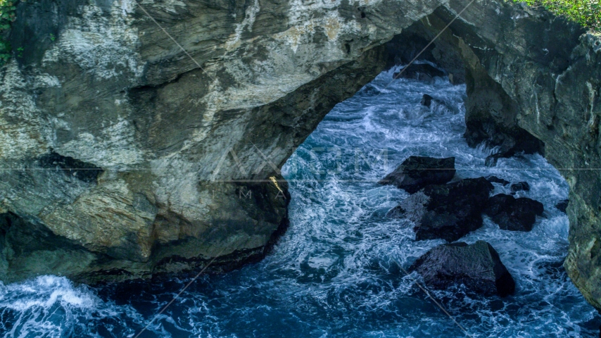 Water-filled sea cave on the coast, Arecibo, Puerto Rico  Aerial Stock Photos | AX101_164.0000000F
