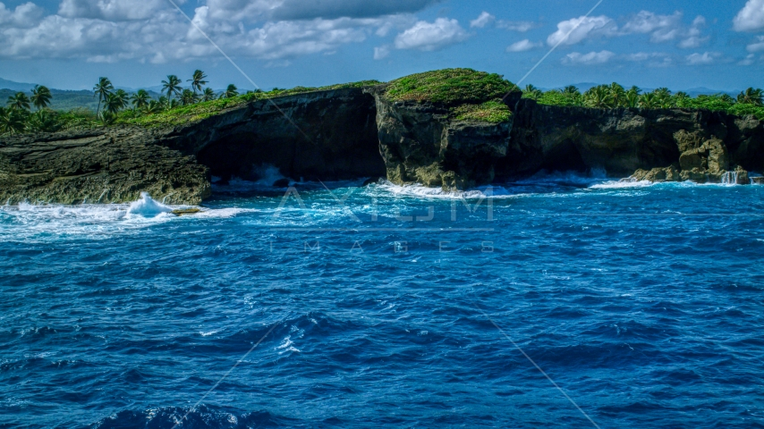 Coastal rock formation and crystal blue water, Arecibo, Puerto Rico  Aerial Stock Photo AX101_165.0000000F | Axiom Images