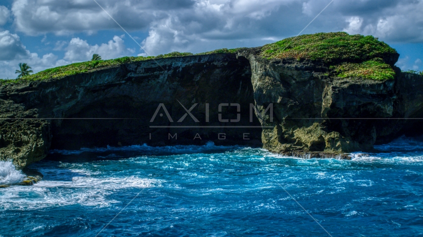 Crystal blue water and a shallow sea cave in Arecibo, Puerto Rico  Aerial Stock Photo AX101_165.0000270F | Axiom Images