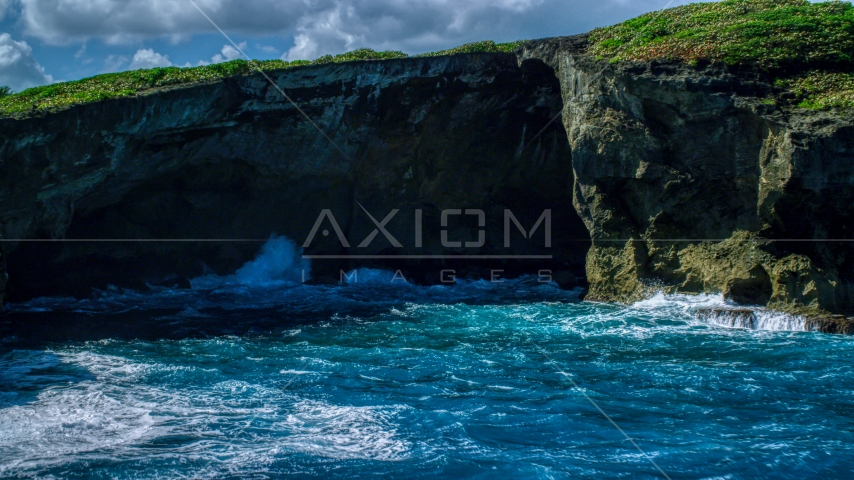 Coastal sea cave in rock formations, Arecibo, Puerto Rico Aerial Stock Photos | AX101_166.0000000F