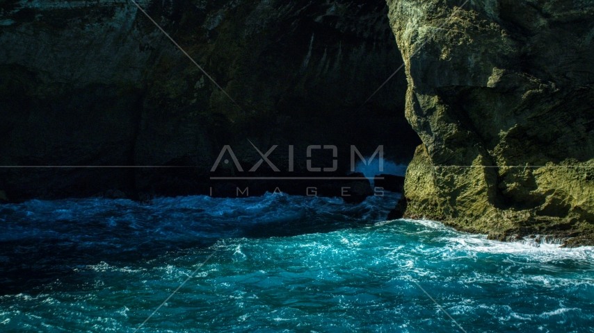 A coastal sea cave in rock formations in the Caribbean, Arecibo, Puerto Rico Aerial Stock Photo AX101_166.0000124F | Axiom Images