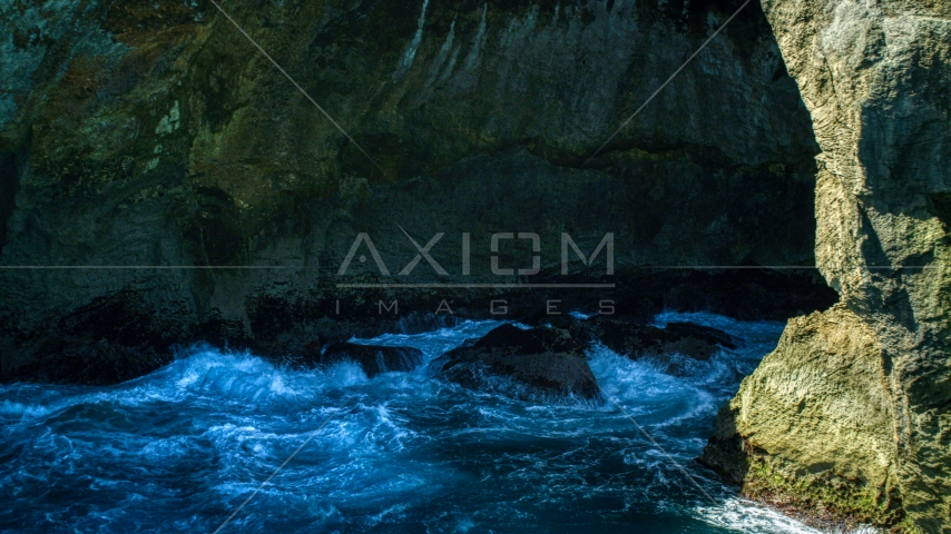 Churning water in a Caribbean sea cave, Arecibo, Puerto Rico Aerial Stock Photo AX101_167.0000000F | Axiom Images