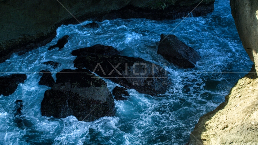 Churning water and rocks in a coastal sea cave, Arecibo, Puerto Rico Aerial Stock Photos | AX101_167.0000171F