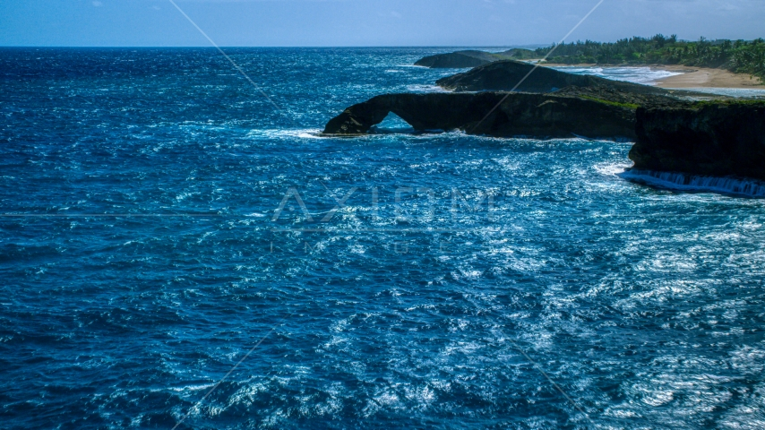Arched rock formation in crystal blue water, Arecibo, Puerto Rico Aerial Stock Photos | AX101_168.0000000F