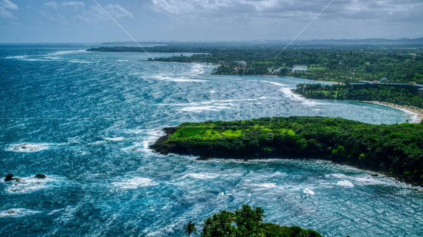 A Caribbean island coast in Vega Alta, Puerto Rico  Aerial Stock Photos | AX101_212.0000000F
