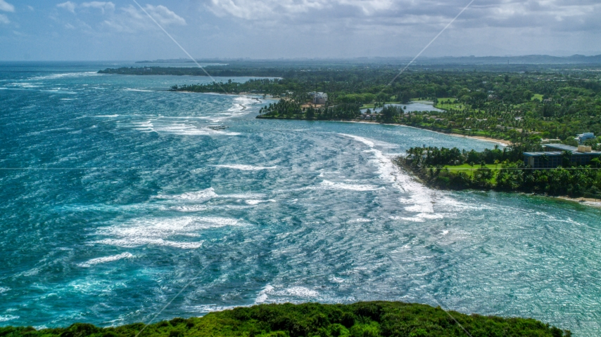 Blue ocean and Caribbean island coastline in Vega Alta, Puerto Rico  Aerial Stock Photos | AX101_212.0000205F
