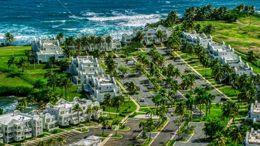 Caribbean island condominium complex in Dorado, Puerto Rico  Aerial Stock Photo AX101_218.0000281F | Axiom Images
