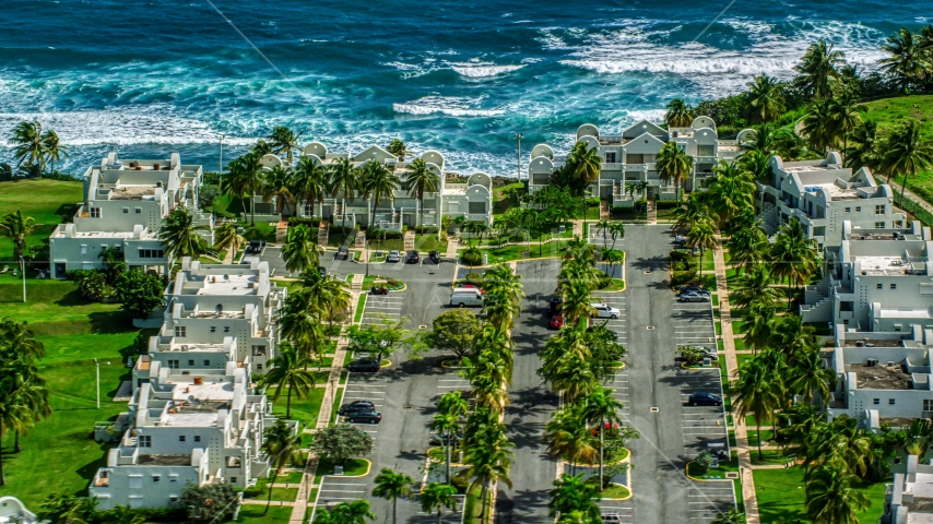 Condominiums overlooking the ocean on a Caribbean island, Dorado, Puerto Rico  Aerial Stock Photos | AX101_219.0000031F