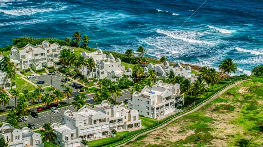 Condominiums on the Caribbean island coast in Dorado, Puerto Rico  Aerial Stock Photo AX101_219.0000256F | Axiom Images