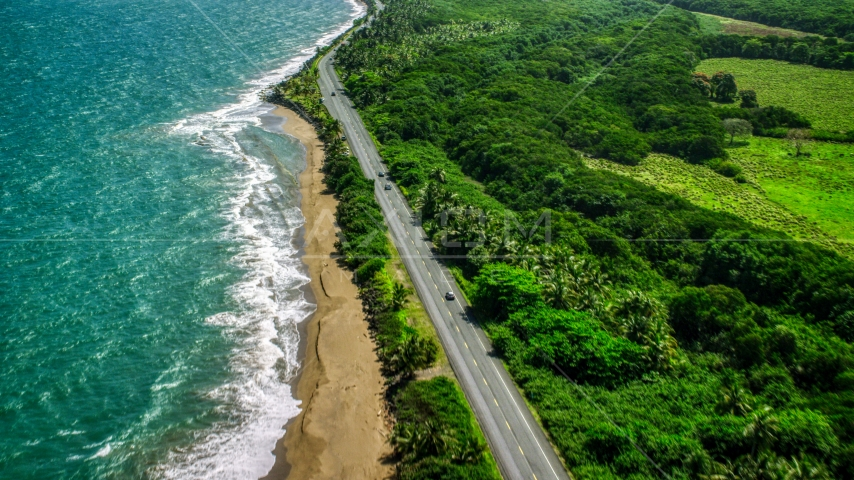 A Caribbean island beach and highway in Dorado, Puerto Rico Aerial Stock Photos | AX101_225.0000241F