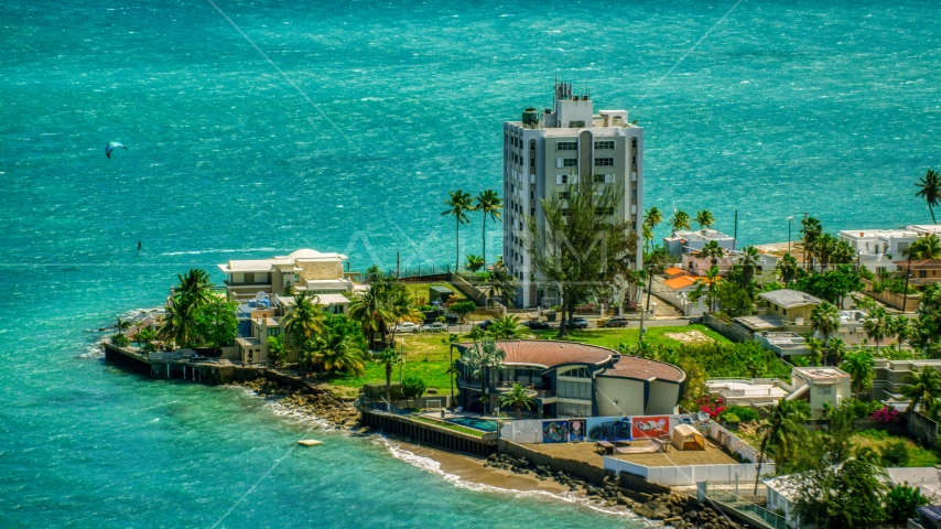 Oceanfront homes and a kite surfer in San Juan, Puerto Rico Aerial Stock Photos | AX102_007.0000151F