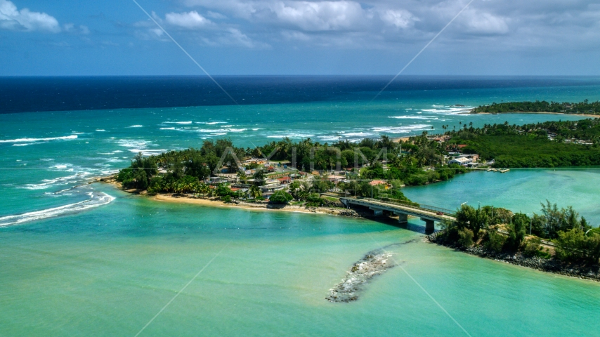 Small island shops beside a small bridge in Loiza, Puerto Rico Aerial Stock Photos | AX102_015.0000000F