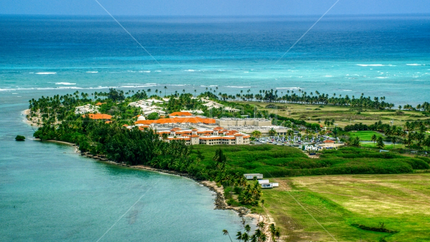 Golf resort hotel by clear turquoise waters, Gran Melia Golf Resort, Puerto Rico Aerial Stock Photo AX102_041.0000146F | Axiom Images