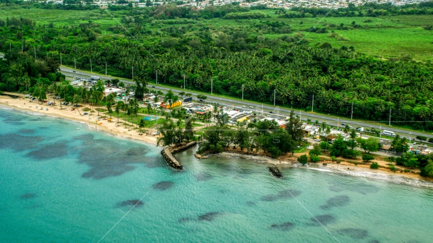Highway and beachfront shops and restaurants in Luquillo, Puerto Rico  Aerial Stock Photo AX102_048.0000000F | Axiom Images