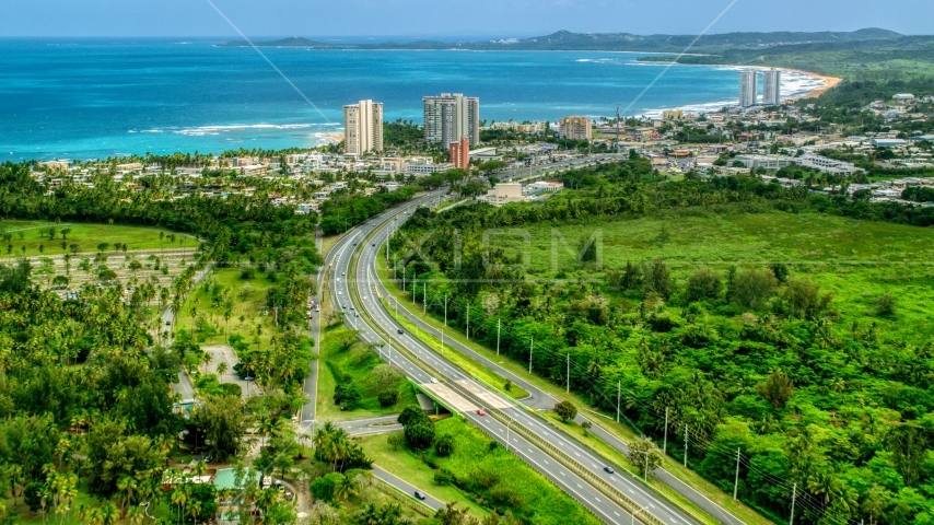 Highway 3 and a beach community with condo complexes in Luquillo, Puerto Rico  Aerial Stock Photo AX102_048.0000244F | Axiom Images