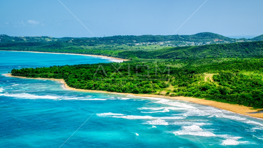 Jungle and beach beside clear blue Caribbean waters, Luquillo, Puerto Rico Aerial Stock Photos | AX102_053.0000000F