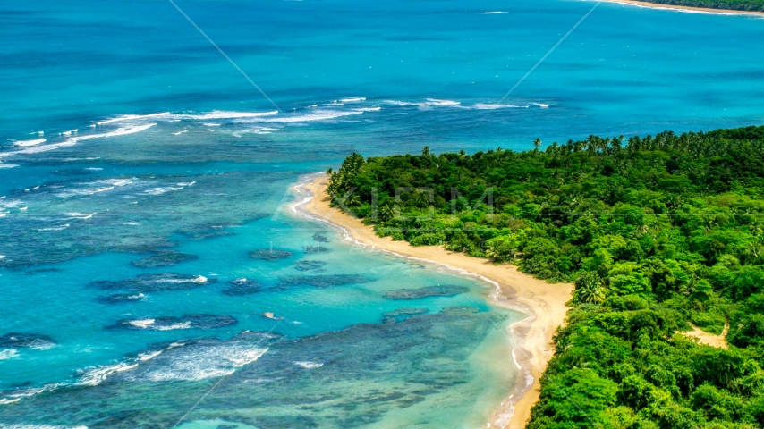 Reefs in the crystal blue waters along the Caribbean beach, Luquillo, Puerto Rico  Aerial Stock Photos | AX102_054.0000000F
