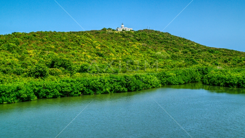 Cape San Juan Light, a hilltop lighthouse in Puerto Rico  Aerial Stock Photo AX102_062.0000000F | Axiom Images