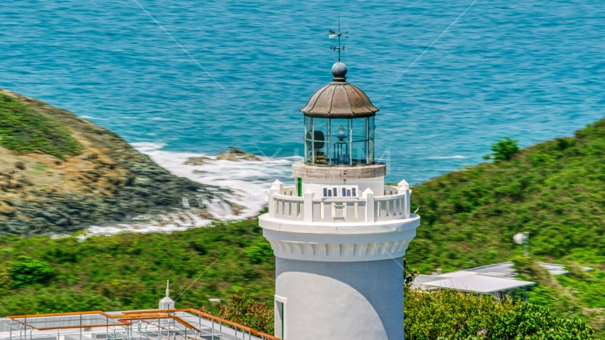 Cape San Juan Light tower in Fajardo, Puerto Rico, with ocean views Aerial Stock Photo AX102_068.0000169F | Axiom Images