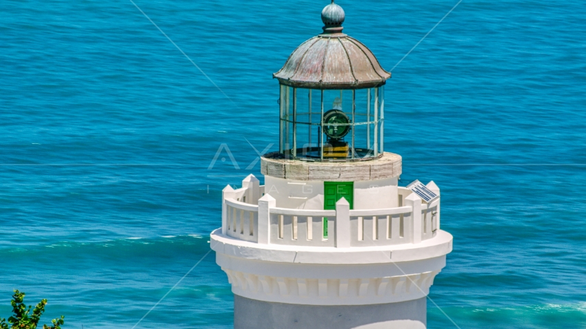 The top of Cape San Juan Light with views of clear blue waters, Puerto Rico Aerial Stock Photo AX102_070.0000071F | Axiom Images