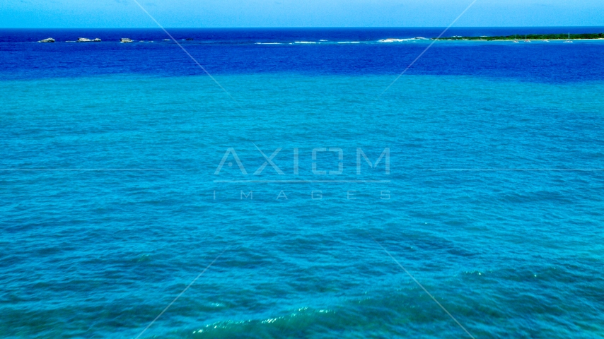 Tiny islands across blue Caribbean ocean in Fajardo, Puerto Rico  Aerial Stock Photos | AX102_071.0000275F