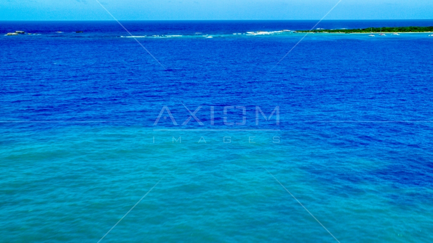 Crystal clear blue Caribbean waters and tiny islands, Rada Fajardo, Puerto Rico  Aerial Stock Photos | AX102_072.0000181F