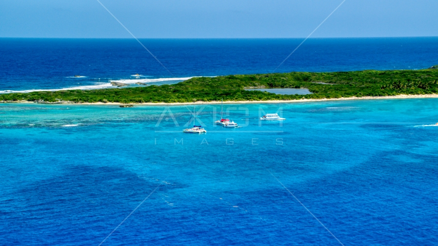 Catamarans near a Caribbean island in tropical blue waters, Rada Fajardo, Puerto Rico Aerial Stock Photos | AX102_073.0000202F