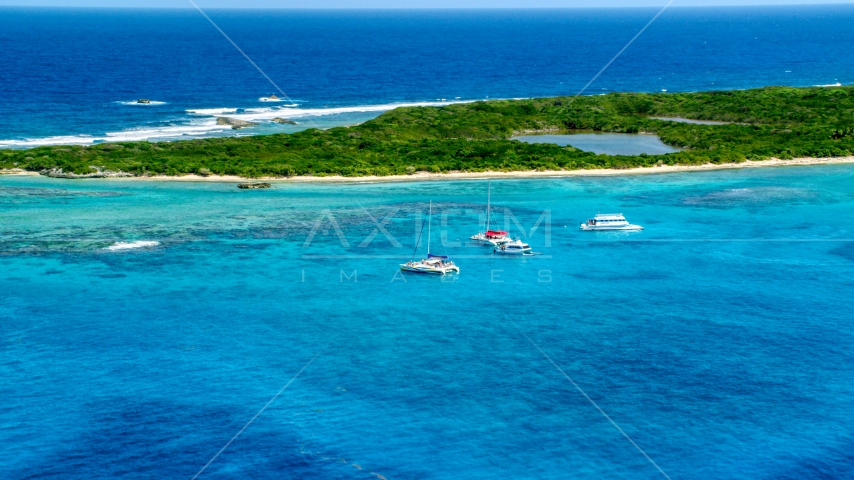 Catamarans in tropical blue waters near reefs and an island, Rada Fajardo, Puerto Rico Aerial Stock Photos | AX102_074.0000000F