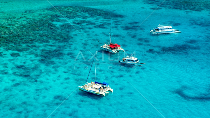 Catamarans in tropical blue Caribbean waters near reefs in Rada Fajardo, Puerto Rico Aerial Stock Photos | AX102_074.0000165F
