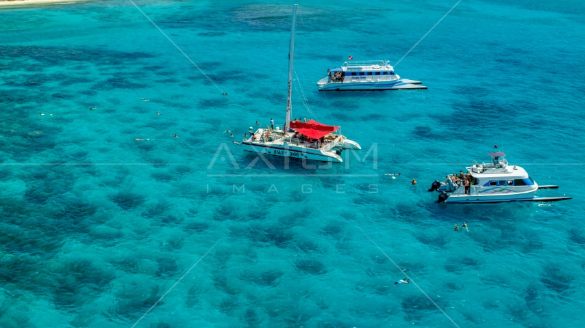 Three catamarans in clear blue water, Rada Fajardo, Puerto Rico  Aerial Stock Photos | AX102_079.0000055F