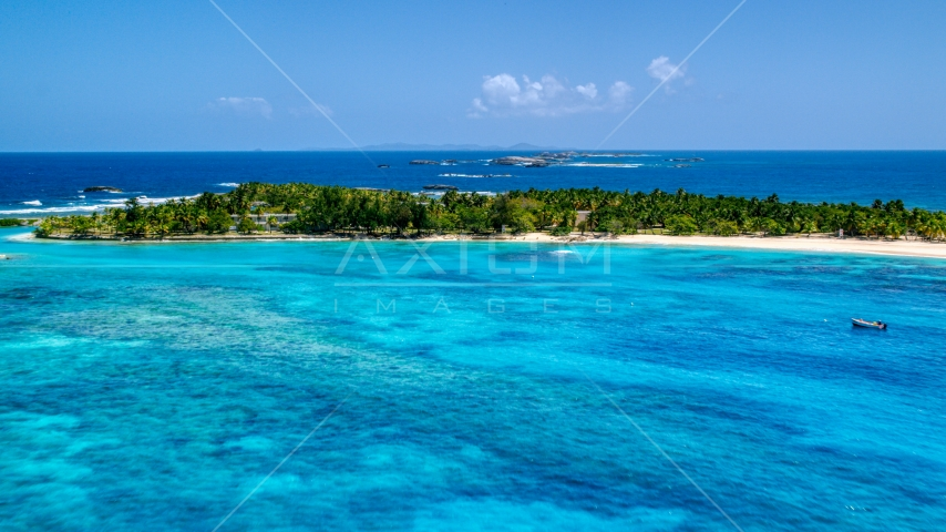 High above tropical blue waters near a small island, Puerto Rico  Aerial Stock Photos | AX102_083.0000278F
