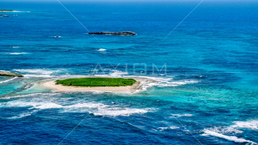 Tiny green island in tropical blue waters, Puerto Rico Aerial Stock Photos | AX102_086.0000000F